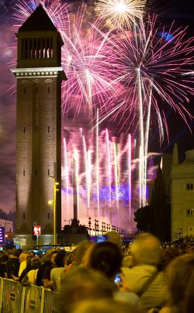 merce: BARCELONA, SPAIN - SEPTEMBER 24, 2015: Firework show at square of Spain in Barcelona, Spain. Firework at closing ceremonies of La Merce Festival