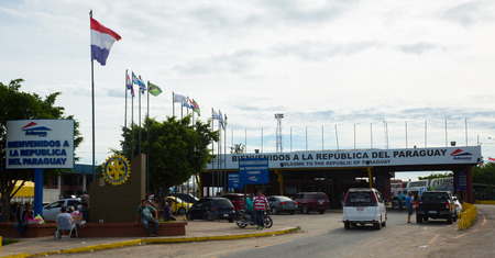 FALCON, ARGENTINA-PARAGUAY BORDER – FEBRUARY 13, 2017:  Tourists and transport waiting to pass Falcon port of entry at Argentina-Paraguay border. Falcon, Argentina-Paraguay border