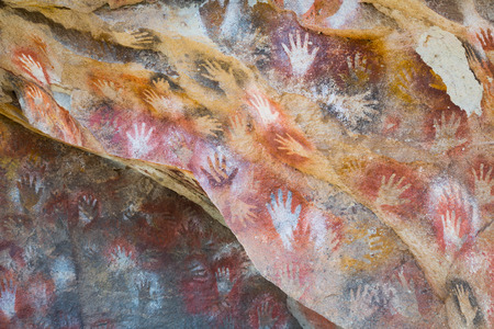 RIO PINTURAS, SANTA CRUZ, ARGENTINA - JANUARY 30, 2017: Rock drawings and handprints in caves of Cueva de las Manos, Santa Cruz (Cueva de las Manos del Rio Pinturas). Patagonia, Argentina, Santa Cruz