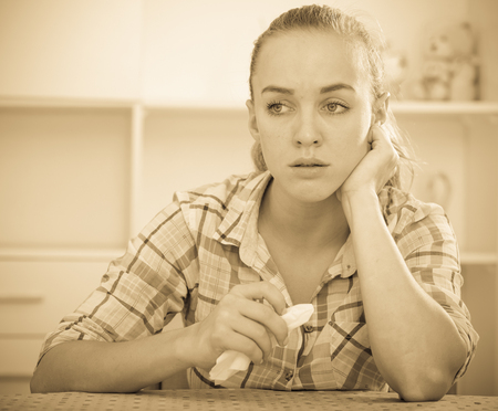 hankie: sad girl with chestnut hair and handkerchief crying Stock Photo