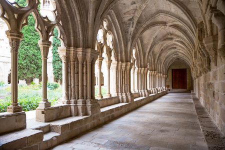 monastic: Stone galleries of inner court of Poblet Monastery at day in Spain