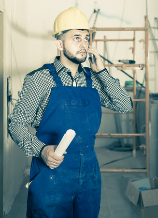 plasterer: Worker is speaking report about work for client at the object