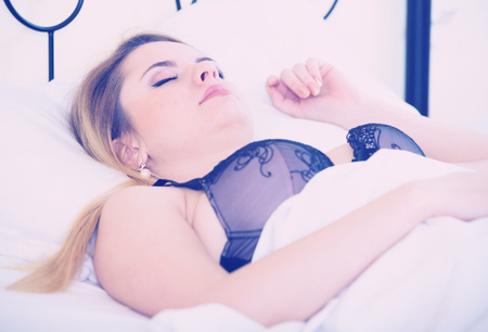 early twenties: Beautiful young blondie sleeping in bed at home Stock Photo