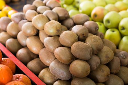 closeup view on the pile of kiwi fruit on the market
