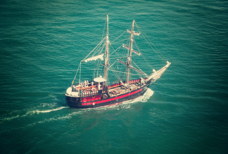 brigantine in open sea in sunny day, top angle
