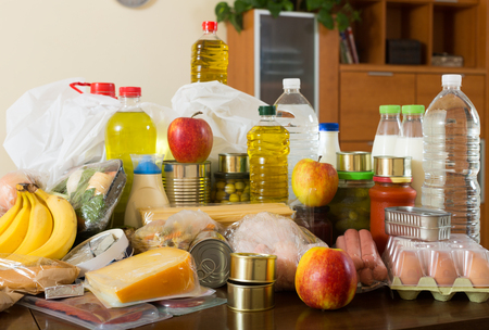 foodstuffs of supermarket on table in home interior