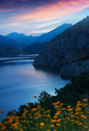 castilla: mountains landscape with lake in twilight. Barrios de Luna reservoir  in Leon,  Spain