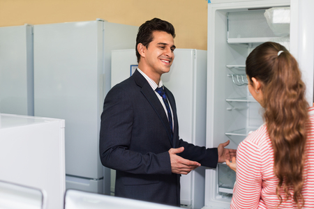 refrigerator: Satisfied smiling customers looking at large fridges in domestic appliances section