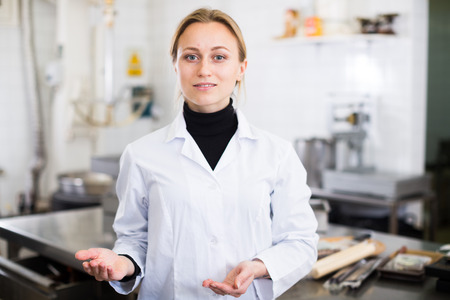 Portrait of young woman working in modern food factory Stock Photo