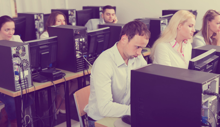 harassing: Bored russian staff sitting at desks and looking at PC screens
