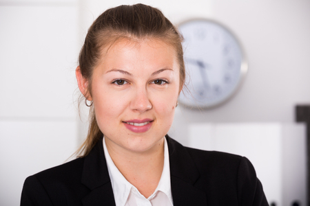 expertize: Portrait of business woman which is working in office.