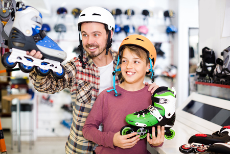 Customers are acquiring quality roller-skates in store. Stock Photo