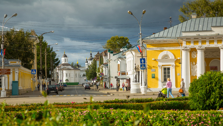 kostroma: KOSTROMA, RUSSIA - AUGUST 28, 2016: Provincial cityscape with people walking through Susaninskaya Square in summer day