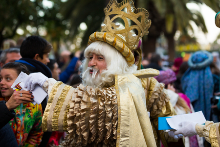 melchor: BARCELONA, SPAIN –  JANUARY 5, 2017: Three of Magi and his retinue take letters from children. Barcelona, Spain
