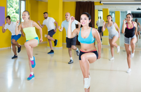 slim athletic positive women and men  dancing strip plastic in class 스톡 콘텐츠