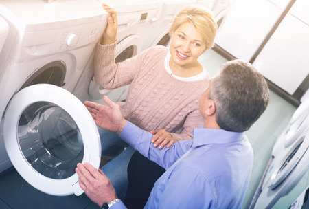 appliances: Mature family couple are selecting washing machine in appliances shop Stock Photo