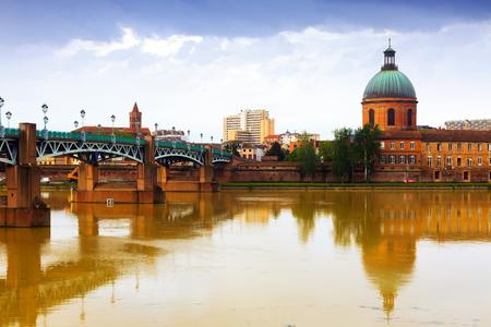 View of Saint-Pierre Bridge over Garonne river and Dome de la Grave in Toulouse