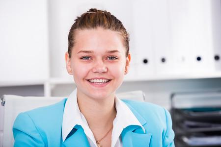 job deadline: Portrait of businesswoman which is working in office. Stock Photo