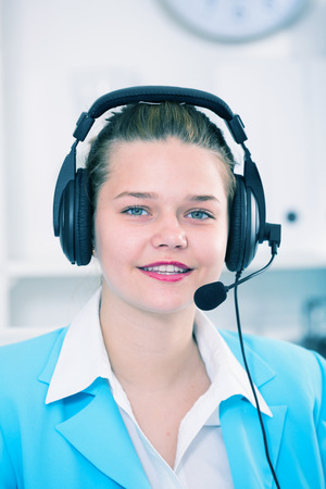 expertize: Female employee having a productive day at call-centre