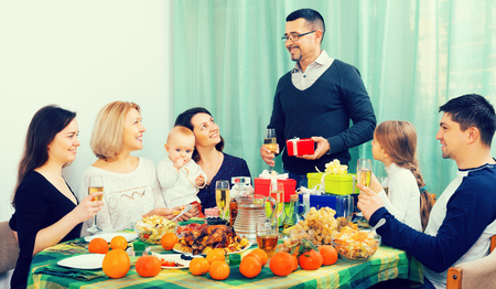 happy person celebrating jubilee with big family at festive table