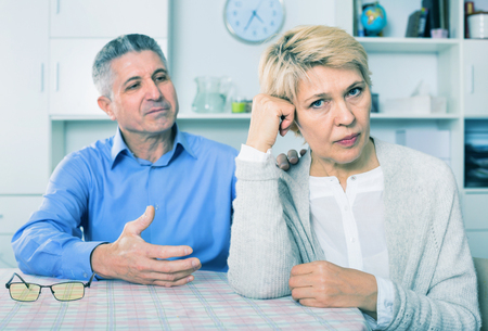 Elderly unhappy mature couple decide family matters and find out relationship in his house