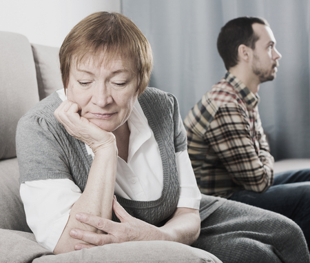 Aged mother arguing with her adult son at home Stock Photo