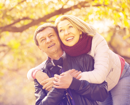 Smiling elderly couple spending time outdoors and enjoying together
