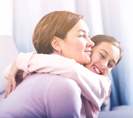 Daughter asks for forgiveness and reconciled with her mother after quarrel Stock Photo