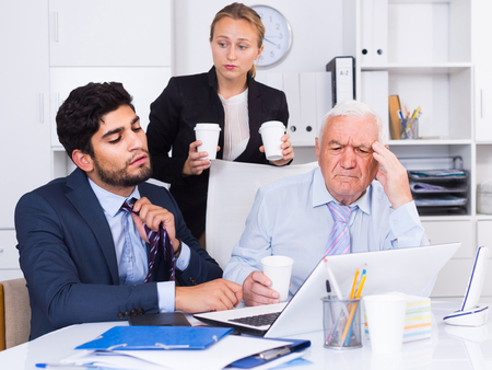 expertize: Mature man is having complicated issue with reports made by subordinates in office.
