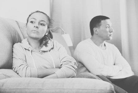 vexation: Husband and wife having disagreement with each other at home Stock Photo