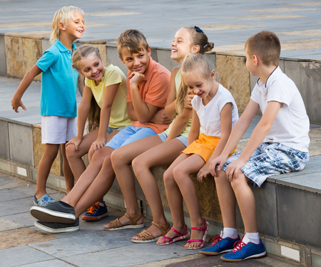 portrait of happy american children spending time outside and playing charades