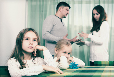 Sad family of four having quarrel at home Stock Photo
