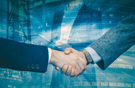 Strong handshake of businessmen confirming successful business partnership Stok Fotoğraf - 83811141