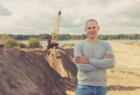 Portrait of worker  at sand pit