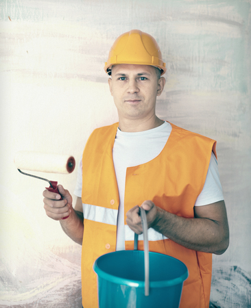 house painters with paint roller is ready for operation photo
