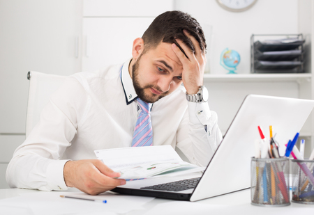 expertize: Stressed man worker facing challenge in project in office