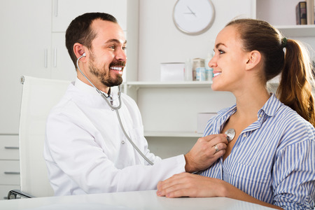 Smiling woman patient with male doctor in medicine center