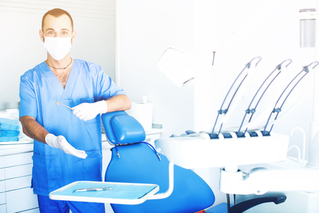 male Dentist is ready to accept client in clinic