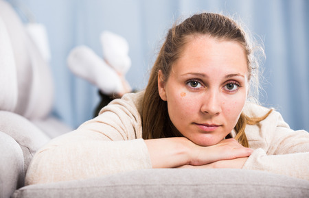 Sad young woman spending day alone at home Stock Photo