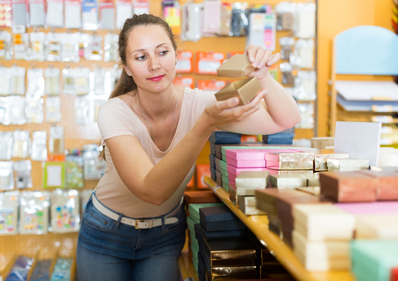 small business: Female customer reviews gift boxes in the store Stock Photo