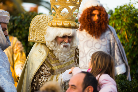 BARCELONA, SPAIN – JANUARY 5, 2017:  Three Magi collecting children's letters at port during celebration. Barcelona, Spain