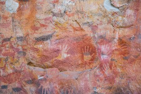 RIO PINTURAS, SANTA CRUZ, ARGENTINA - JANUARY 30, 2017: Rock drawings and handprints in caves of Cueva de las Manos, Santa Cruz (Cueva de las Manos del Rio Pinturas). Patagonia, Argentina, Santa Cruz