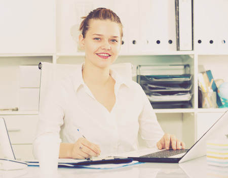 expertize: Businesswoman is working with documents and laptop in the office. Stock Photo
