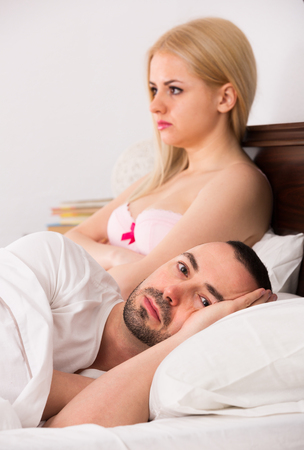 impotent: Upset young  family keeping silence in bed
