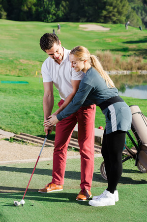 brassy: Golf coach explains to the man the basics of playing
