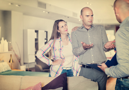 Outraged customers revealing discontent with furniture seller due to poor service Stock Photo