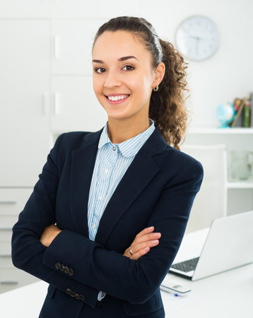 Successful and confident positive woman working in modern office