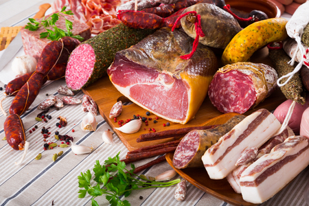Display of mince, sausages and meat with spices on table Stock Photo