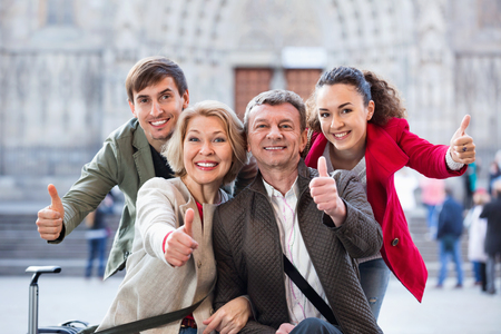 Positive cheerful  family of four together in close up outdoor Stock Photo