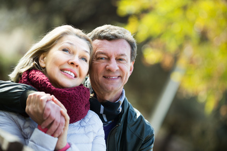 Portrait of positive mature couple spending time outdoors and enjoying together Stock Photo